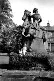 Morag Stewart  (sister of Alan Stewart) and dog, Lassie, sitting on the statue in front of Clermiston House, in the early-1960s