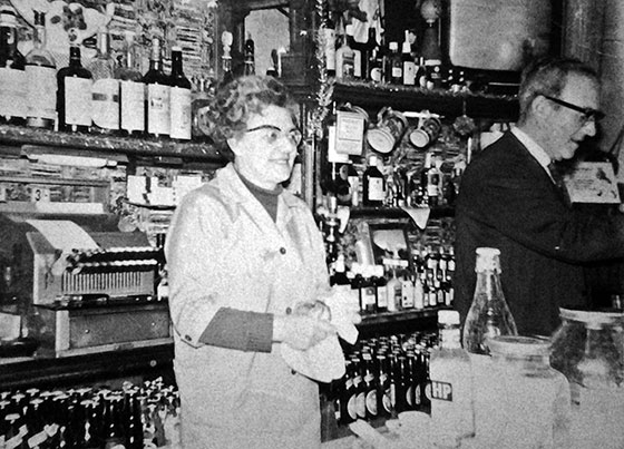 Davey and Nellie behind the bar at Davey's Bar, Leith