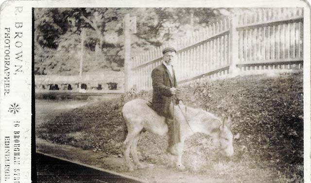 Edinburgh professional photographer, Robert Brown, on a donkey in his father's studio in Aberdour