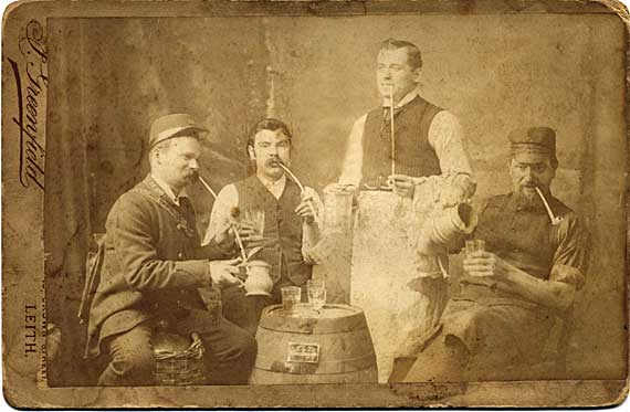 Cabinet print of four men with clay pipes and drinks  -  by J Greenfield