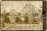 Cabinet Print by Philip E Low, of a group in a studio boat in front of a backdrop of the Forth Bridge