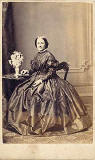 G W Fisher  -  Carte de visite  -  Lady and vase of flowers