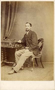 A carte de visite by the Edinburgh professional photographer John Ross   -  from his studio at 36 North Hanover Street  -  man on a chair