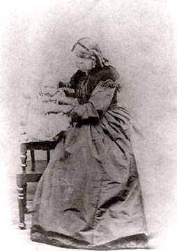 Carte de visite from the studio of Scott & Oman  -  Mary Ann Oman, photographed with one of her children, probably Jemima