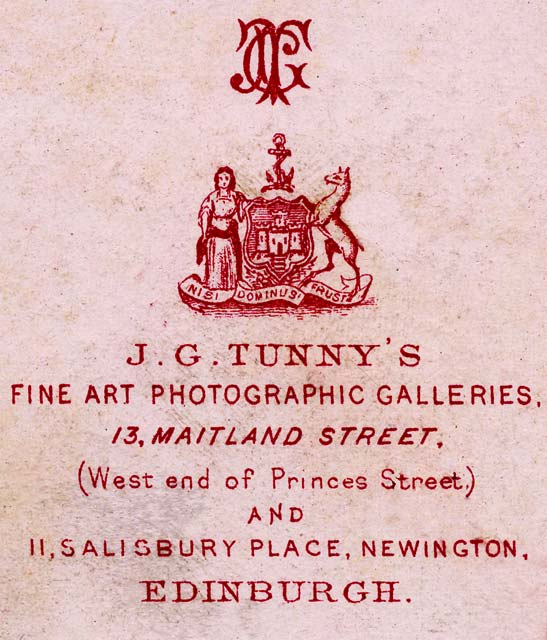 Zoom-in on the detail on the back of a Carte de Visite by Tunny & Co  -  1870-1874  -  Man in kilt
