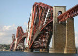 The Forth Rail Bridge, covered in scaffolding and partially encapsulated for painting.