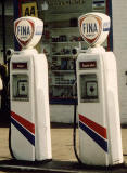 Zoom-in to two pumps on the left at a Fina garage in the Scottish Highlands
