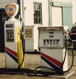 Zoom-in to two petrol pumps on the right at a Fina petrol station in the Scottish Highlands