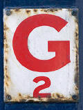 Small enamel plate with the lettet 'G'  -  ,photographed at  Bernard Street, Leith.  Did this have a connection with gas/