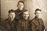 Four  brothers, all members of the Scots Guards, taken at Jerome's Studio, 79 Leith Street, in 1939
