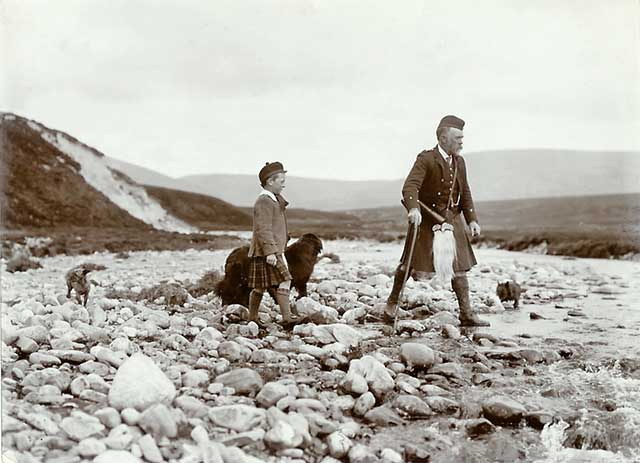 Photograph from the family of Horatio Ross  -  Hunting and Shooting in the Scottish Highlands  -  Man, boy and dog