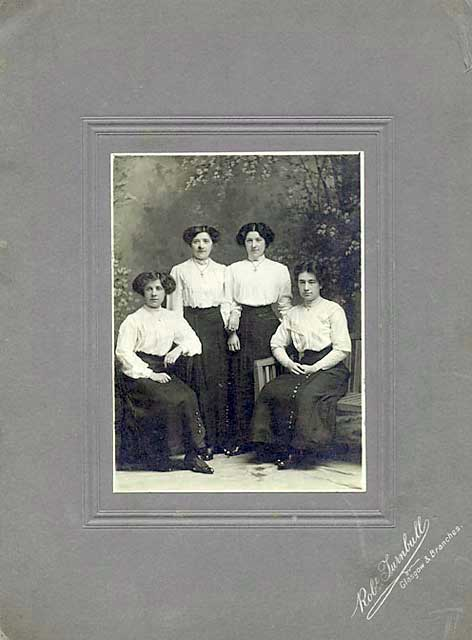 Photograph by Robert Turnbull  -  four ladies