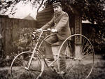 Ebenezer Turner in his back garden, sitting on his tricycle