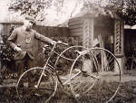 Ebenezer Turner in his back garden, standing beside his tricycle