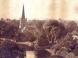 Zoom-in to an A W Elson Photograph  -  river and church  -  Where is it?