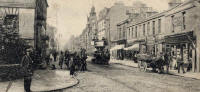 Zoom-in on a postcard by J K Home Crawford  -  Looking along Portobello High Street from its junction with Brighton Place