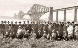 K Ltd Postcard  -  A large group of men and ladies in front of the Forth Rail Bridge