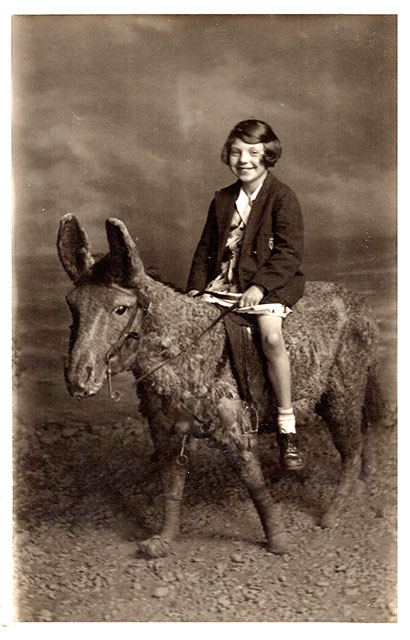 Photo from the studio of Robert McLelland  -  Girl on a Stuffed Donkey