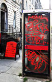 Telephone Box, covered in fraffiti, Buccleuych Street, Edinburgh  -  July 2013