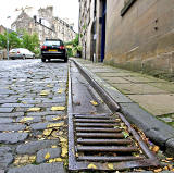 Metal Gutter and Drain at the edge of Calton Hill, the steep street leading up from Leith Street to Regent Road
