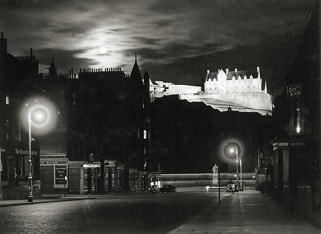 Photograph by Norward Inglis  -  View towards a floodlit Edinburgh Castle from Castle Street