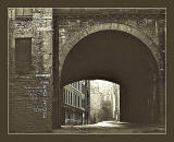 Looking to the west along Cowgate, and through one of the arches of South Bridge, towards the Grassmarket, around 1970