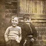 Kenny Blackwood and Brian Gilhooley at 41 Dumbiedykes Road around 1955