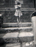 Linda Graham, aged 4, standing on the steps to the houses in Dumbiedykes Road, near the 'Big Green'