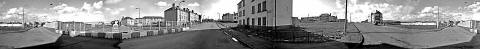 Monochrome panoramic view of Craigmillar from Niddrie Mains Drive - as the building of the new school commences