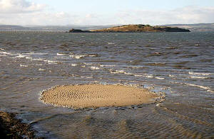 Cramond Island and san at Silverknowes about to be covered by the incoming tide