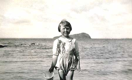Girl on the Beach, around 1925.  Craigleith Island in the background