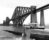 The ferry, Queen Margaret, approaches Hawes Pier at Queensferry with the Forth Bridge in the background