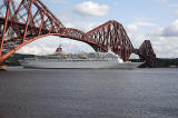 Crruise Liner, 'Black Watch' passes under the Forth Bridge on her way to dock at Rosyth