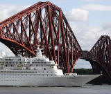 Zoom in on a photo of Crruise Liner, 'Black Watch' passing under the Forth Bridge on her way to dock at Rosyth