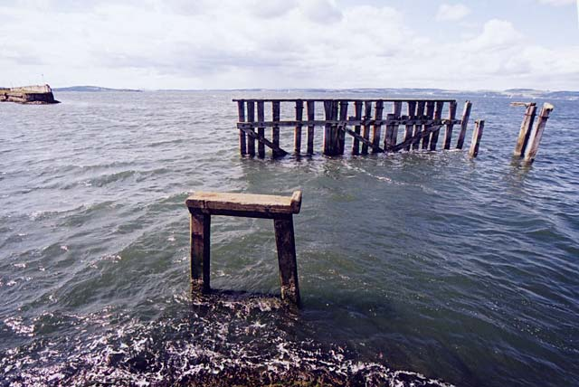 The remains of the old wooden pier at the end of Granton Harbour.'s Eastern Breakwater