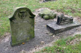Gravestone in North Leith Graveyard  -  including a broken gravestone with a skull