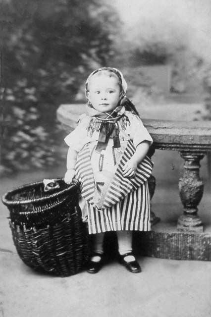 Photograph of a girl aged two, dressed in Newhaven Fishwives' Costume  -  American Studios
