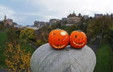 Haloween  -  Two pumpkins placed on the large stone at the SE corner of The Mound Precinct - Balmoral Hotel, Edinburgh Old Town and former Bank of Scotland Head Office are in the background