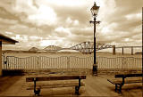 Queeensferry  -  The Forth Bridge with railings, lamp posts and benches