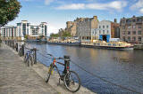 Cycles on the North Bank of the Water of Leith;  barges on the south bank, at The Shore, Leith