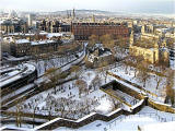 Looking down on the Caledonian Hotel and St Cuthbert's Church and graveyard from Edinburgh Castle  -  January 2010