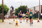 Edinburgh Waterfront  -  The 2003 Edinburgh Marathon passes the lighthouse in West Harbour Road  -  15 June 2003