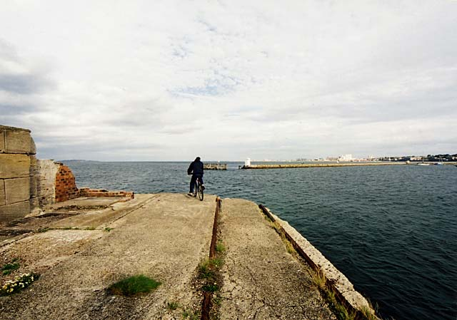 Edinburgh Waterfront  -  A cyclist reaches the end of Western Breakwater, Granton Harbour  -  14 September 2003