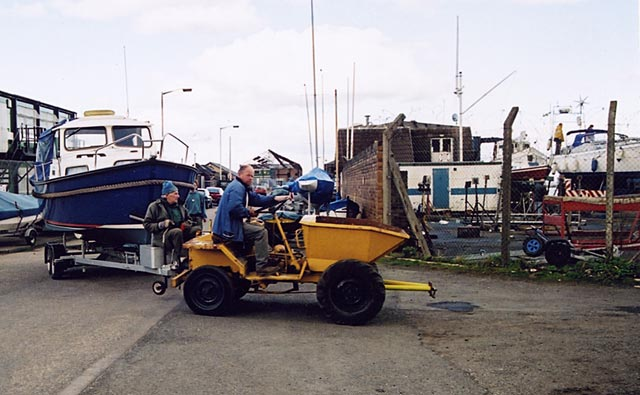 Edinburgh Waterfront  -  A dumper truck takes a boat from Middle Pier into the Royal Forth Yacht Club boatyard  -  7 April 2004