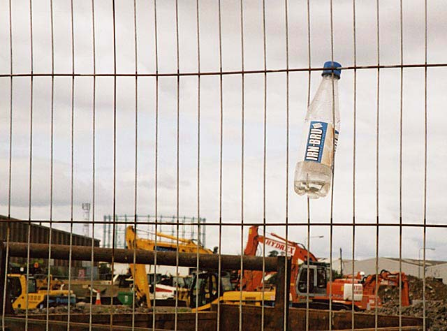Looking from Granton Middle Pier across the building work at Western Harbour with the one remaining gasometer in the background - with the Irn Bru bottle still wedged into the fence.