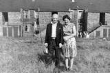 Rob Cleary's grandfather and his daughter outside Jewel Cottages, Bingham  -  around 1946