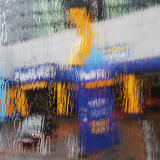 Photo taken in the rain from the front seat on the upper deck of a Lothian Bus  -  Kwikfit Garage, oposite Fountain Park, Fountainbridge