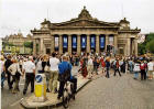 Crowds gather outside the Royal Scottish Academy in Princes Street to watch the Edinburgh Festival Cavalcade on 3 August 2003