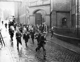 Workers departing from the North British Rubber Company, Fountainbridge at the end of the shift