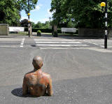 One of the live-size cast iron figures in the artwork '6 Times' by Antony Gormley.  The statues are sited, most in the Water of Leith, between the Scottish National Gallery of Modern Art and Leith Docks